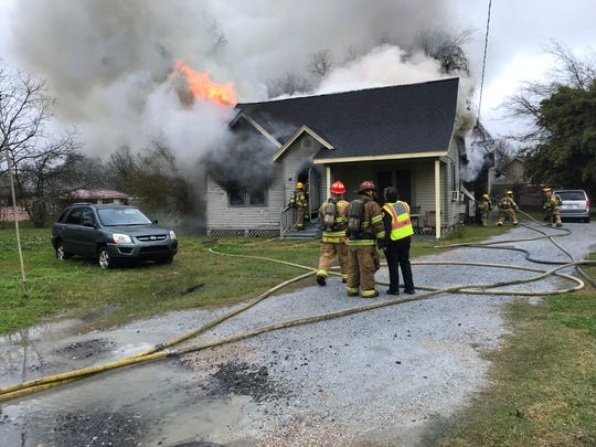 The Lafayette Fire Department battles a blaze on Lincoln Street.