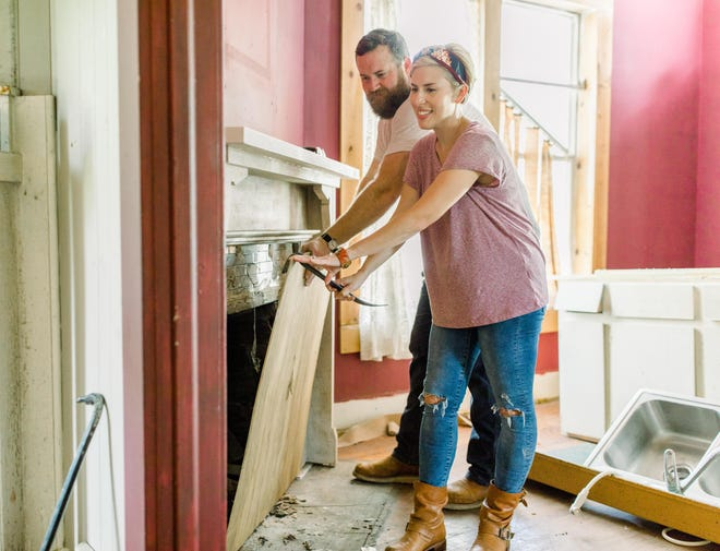 "As seen on ""Home Town,"" Ben and Erin Napier work together to restructure the fireplace of the Yeager house, which will be completely renovated. (Courtesy HGTV)"