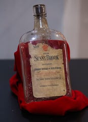 A bottle of bourbon from the Sunny Brook Distillery Co. about 1908.  The bottle is on display in a newly installed exhibit at the Louisville Slugger Museum and Factory in Louisville, Ky. Jan. 23, 2020.  The exhibit highlights an African American baseball team, the Louisville Unions, that played in 1908 in Louisville, 12 years before the formation of the Negro Leagues.  The exhibit will be on display through Labor Day.