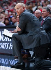 U of L head coach Chris Mack watched action against Georgia Tech during their game at the Yum Center in Louisville, Ky. on Jan. 22, 2020.
