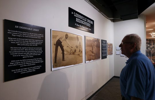 Gary Fenner, a tour guide at the Louisville Slugger Museum and Factory, looked at a newly installed exhibit in Louisville, Ky. on Jan. 23, 2020.  The exhibit highlights an African American baseball team, the Louisville Unions, that played in 1908 in Louisville, 12 years before the formation of the Negro Leagues.  The exhibit will be on display through Labor Day.
