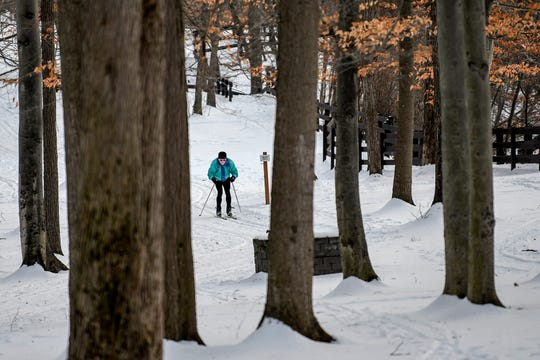 Lansing resident Bruce Uhal cross country skis on a trail at Burchfield Park on Wednesday, Jan. 22, 2020, in Holt. Uhal said that he likes to ski in the park twice a week if there's enough snow.