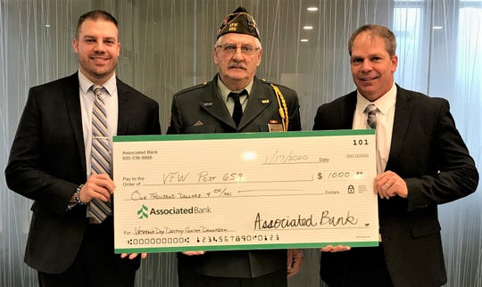 Commander Randy Ayotte of Manitowoc VFW Post 659 (center) receives a $1,000 check from Associated Bank on Jan. 17. Senior Bank Manager Bret Kuether (left) and Market Manager Scott Throndson (right) made the presentation.
