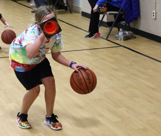 Reese Redman, 9, of Galion runs a drill during Erskine Braggs' skills clinic on Wednesday at the Mansfield Community Outreach Center.