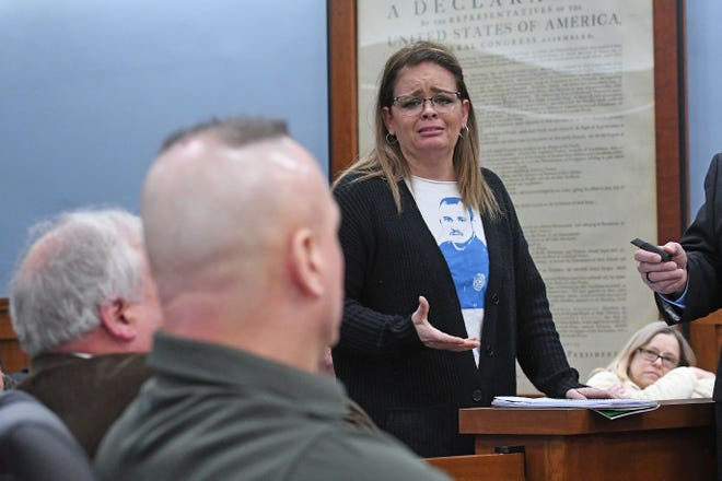 Trina Evans wears a shirt with a picture of her late husband Brian Evans as she addresses Brian's brother, Larry Evans Jr., who was found not guilty by reason of insanity on 19 counts, including two charges of aggravated murder, in connection with the Dec. 26, 2007 homicides.