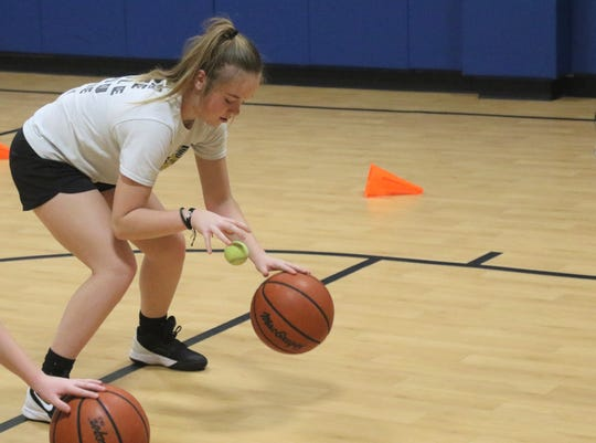 A young basketball player works on hand-eye coordination during a drill on Wednesday at the Mansfield Community Outreach Center.