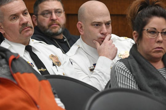 Mansfield Police Chief Keith Porch and Assistant Chief Joe Petrycki listen to testimony Thursday morning during the Larry Evans Jr. hearing.