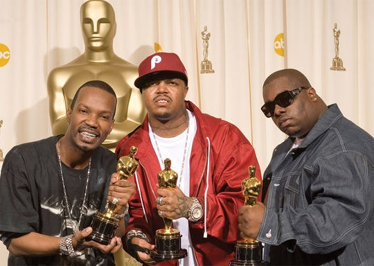 Best Original Song winners (from left)  Jordan Houston (Juicy J), Paul Beauregard (DJ Paul) and Cedric Coleman (Frayser Boy) brandish their Oscar gold.