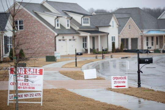 Real estate signs are seen in the yards of homes throughout Piperton Preserve on Thursday, Jan. 23, 2020, in Piperton.