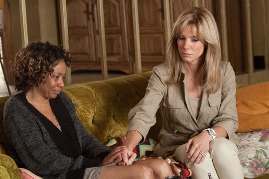 "Sandra Bullock (right)  won an Oscar for her lead role in the Memphis-set ""The Blind Side."" At her side is Memphis-born actress Adriane Lenox, as football star Michael Oher's mother."