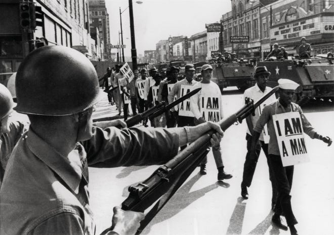 March 29, 1968 - National Guard bayonets block Memphis' famed Beale Street as marchers supporting striking sanitation workers pass through downtown.