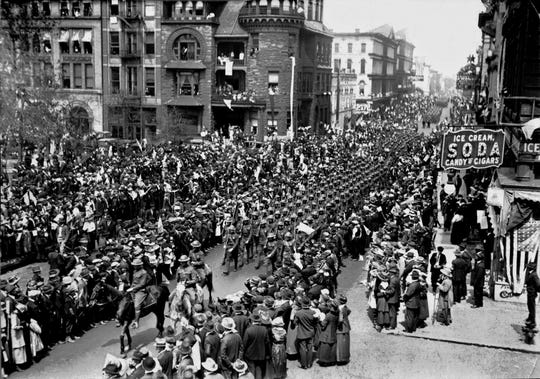 World War I veterans from Memphis parade down Second Street after their return from France in 1919. A reported 100,000 people turned out to welcome members of the 115th Field Artillery. The welcoming throngs covered the sidewalks and the streets from the Union Depot up Main Street to Poplar. In places the regiment, led by Col. Harry S. Berry and his mounted staff, literally had to squeeze through the crowds eager to get the nearest view.