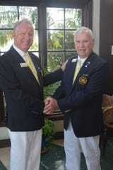 Marco Island Yacht Club Outgoing Commodore Jeff Comeaux, left, congratulates 