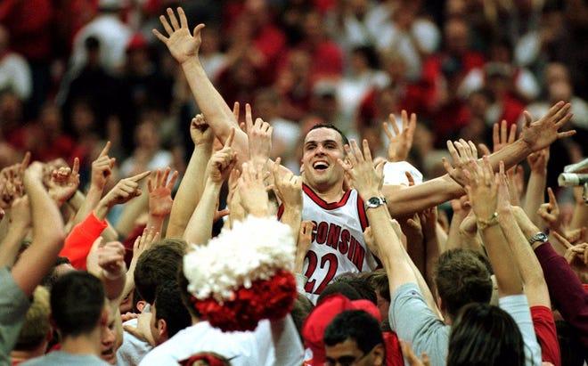 Wisconsin's Mike Kelley rides high on the shoulders of Badger fans after Wisconsin defeated 12th ranked Indiana 56-53 Sunday, March 5, 2000 in Madison, Wis.