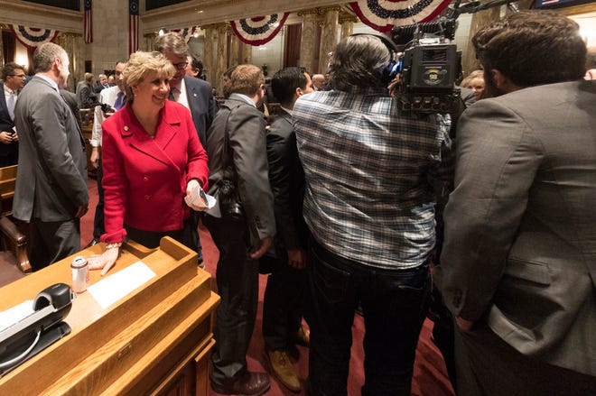 State Sen. Jennifer Shilling, D-La Crosse, scoots around reporters after Gov. Tony Evers delivered his State of the State address at the Capitol in Madison in January.