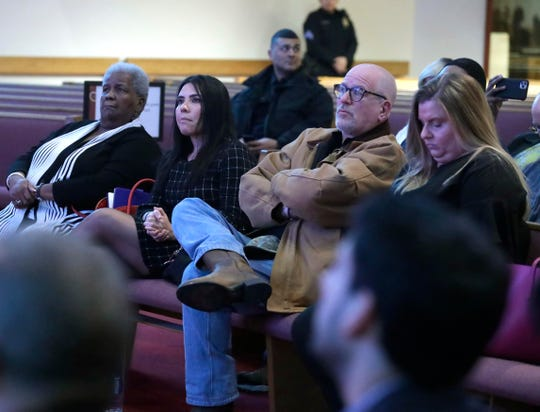 Members of the Milwaukee Fire and Police Commission join the audience as they listen to Milwaukee Police Chief Alfonso Morales share crime statistics.