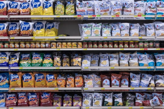 Woodman's Market in Menomonee Falls boasts rows of potato chips, the snack food with a colorful history.