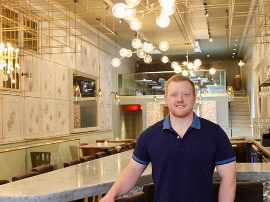 Chef Andrew Miller, shown inside his fine dining seafood restaurant Third Coast Provisions, will be opening a casual pizza restaurant named Flourchild at 722 N. Milwaukee St.