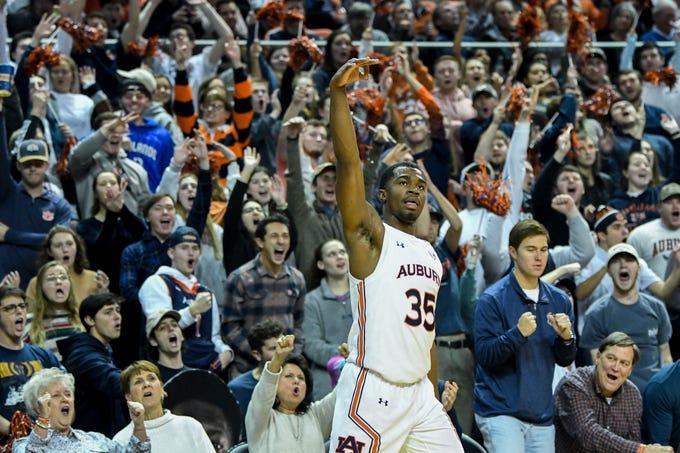 Auburn guard Devan Cambridge (35) celebrates a 3-point basket against South Carolina on Wednesday, Jan. 22, 2020, in Auburn, Ala.