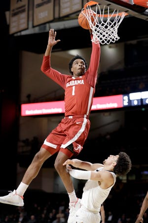 Alabama forward Herbert Jones (1) scores over Vanderbilt guard Scotty Pippen Jr. in the second half of an NCAA college basketball game Wednesday, Jan. 22, 2020, in Nashville, Tenn. (AP Photo/Mark Humphrey)