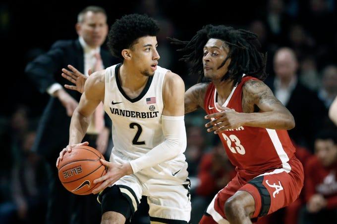 Alabama guard John Petty Jr. (23) defends against Vanderbilt guard Scotty Pippen Jr. (2) in the first half of an NCAA college basketball game Wednesday, Jan. 22, 2020, in Nashville, Tenn. (AP Photo/Mark Humphrey)