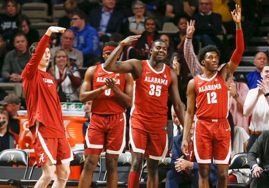 Players on the Alabama bench celebrate after a score against Vanderbilt in the first half of an NCAA college basketball game Wednesday, Jan. 22, 2020, in Nashville, Tenn. (AP Photo/Mark Humphrey)
