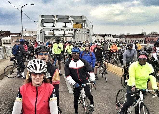 Cyclists ride on the Edmund Pettus Bridge in Selma, Ala., in 2015, during the 50th anniversary of the Selma-to-Montgomery civil rights march.