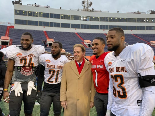 Alabama head coach Nick Saban (center) is pictured beside former Alabama players Terrell Lewis (24), Jared Mayden (21), Jalen Hurts (1), and Anfernee Jennings (33) following Wednesday's South Team practice for the 2020 Senior Bowl at Ladd-Peebles Stadium in Mobile.