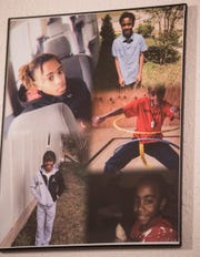 Pictures of Jaylan Saunders hangs in his mom's house in Montgomery, Ala., on Wednesday, Jan. 22, 2020. Jaylan Sanders was shot and killed while he was sleeping through his window on Jan. 24, 2019.