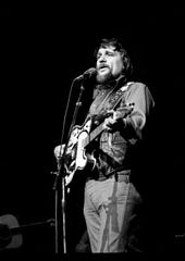 Waylon Jennings performs a sold-out concert at the Grand Ole Opry House in 1980.