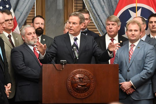 Gov. Bill Lee, center, speaks during a news conference at the state Capitol in the Old Supreme Court chamber on Thursday, Jan. 23, 2020.
