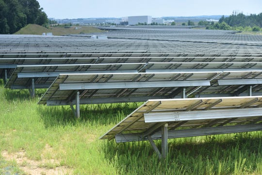 Volkswagen's 65-acre solar farm stretches to the north from its main buildings at the automotive factory campus in Chattanooga.