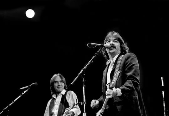 John Prine, right, one of the earlier acts, performs for a crowd of more than 10,000 during Charlie Daniels Band's 6th annual Volunteer Jam at the Municipal Auditorium Jan. 12, 1980.