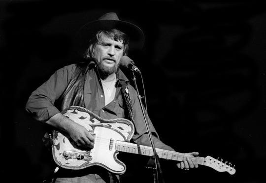 Waylon Jennings, who joined Johnny Cash, Tammy Wynette, George Jones, June Carter and others, performs during a sold-out concert at the Grand Ole Opry House on Jan. 31, 1980.