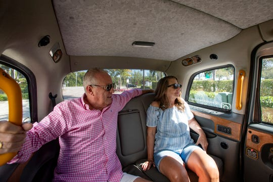 Paul Stevens and Lesley Cotton enjoy a ride in a London cab, Thursday, Jan. 23, 2020, through downtown Naples.