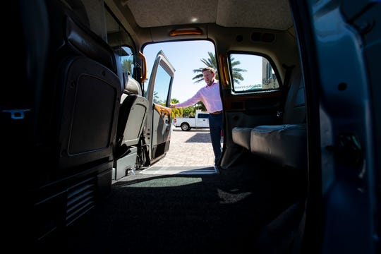 Paul Ditheridge, director of marketing at Naples Bay Resort talks shows off the features of their London cab, Thursday, Jan. 23, 2020, in Naples.