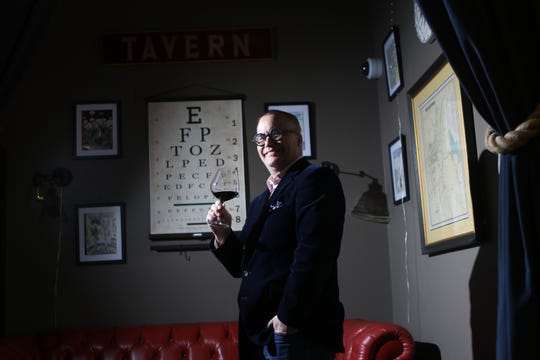 Owner of Jockey Hollow Bar & Kitchen, Christopher Canon poses with a glass of wine, in Morristown.