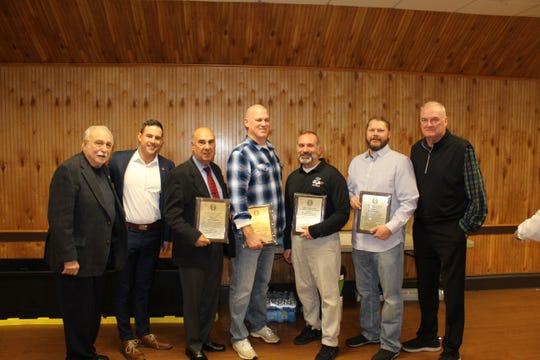Passaic County Chapter of National Football Foundation President Bill Farkas, Rutgers Assistant Coach Drew Lascari, referee Pete DeFranco, DePaul coach John McKenna, Passaic Tech coach Matt Demarest, Wayne Valley coach Roger Kotlarz and NFL referee Ed Camp.