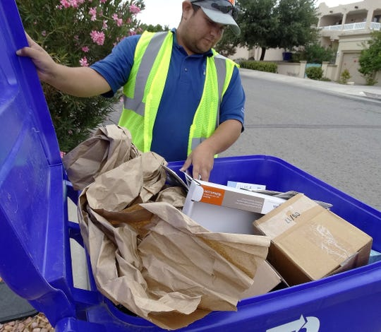 South Central Solid Waste Authority staff member Arturo Ramos inspects a curbside recycling bin to be sure there is no contamination and the materials are all acceptable items.