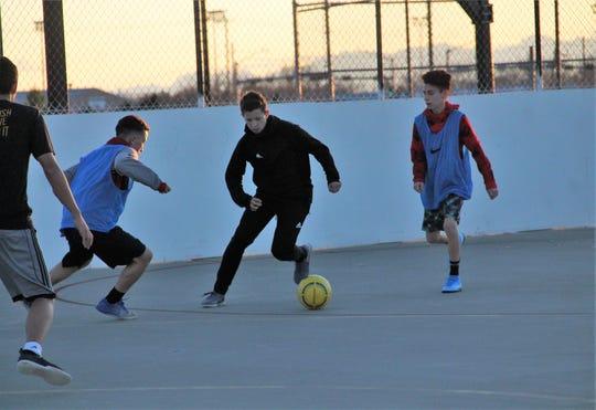 The Alamogordo High School Boys soccer teams practice at Washington Park.