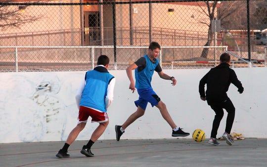 The Alamogordo High School boys soccer teams practice at Washington Park roller rink.