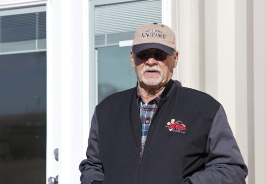 Larry Waldroup stands next to the door to the shipping container home, Thursday, Jan. 23, 2020, in Kirtland.