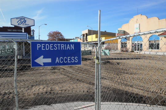 A cyclone fence encircles a four-block stretch of East Main Street in downtown Farmington on Jan. 15, 2020, as Complete Streets construction continues.