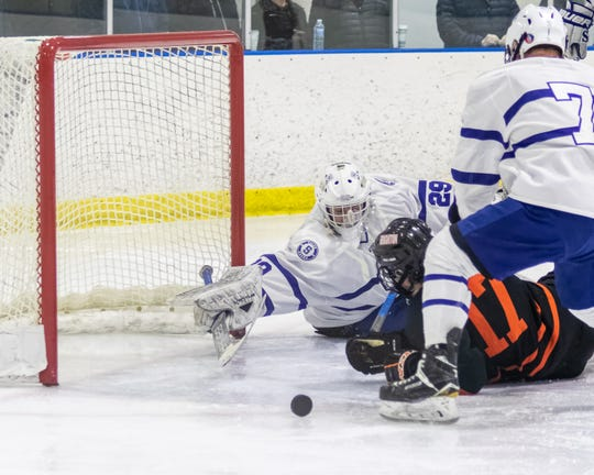Salem goalie Andre Genereux reaches for the puck that Brighton's Lars Erkkila is trying to poke in Wednesday, Jan. 22, 2020 in Plymouth. (TIMOTHY ARRICK - For Hometown Life)
