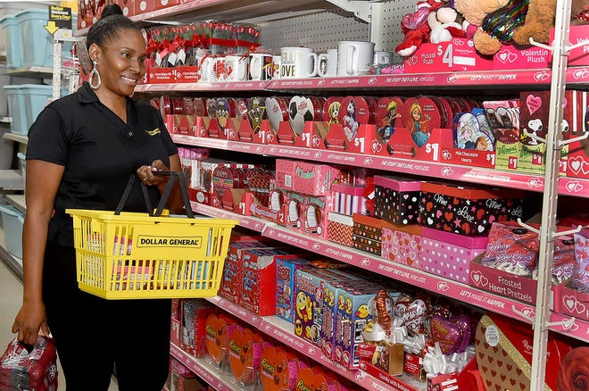 Port Barre Dollar General store manager Crystal Richard walks through the Valentine's Day section of the new store, which will host a relocation grand opening on Saturday.