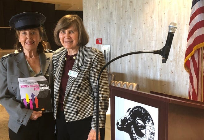 Dr. Priscilla H. Porter, with Martha McCool, CVAP first vice president of programs, shows off her book.