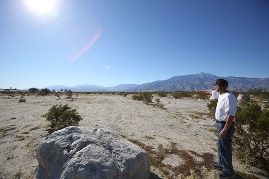 Word of Life Fellowship in Desert Hot Springs, purchased land behind his church with plans to build a homeless shelter. In this photo Deacon Bobby Canela is photographed on the lot looking south for the proposed development.