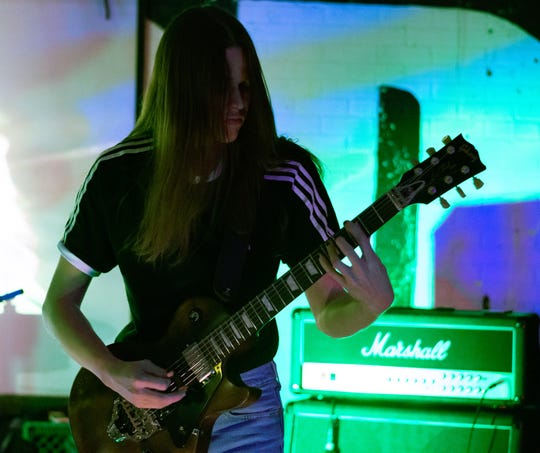 Jaxon Fischer of Instigator playing guitar at The Hood Bar and Pizza in February 2019.