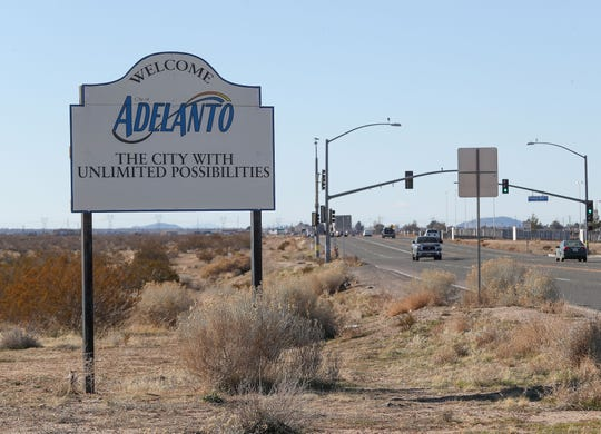 "A sign with the Adelanto city motto ""the city with unlimited possibilities"" welcomes visitors to the city on Air Expressway Road in Adelanto, Calif., on Jan. 22, 2020."