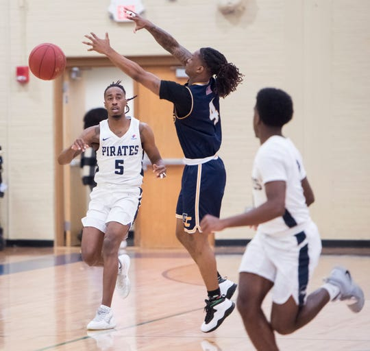 Shawndarius Cowart (5) passes the ball up court during the Gulf Coast State vs Pensacola State men's basketball game at Pensacola State College on Wednesday, Jan. 22, 2020.